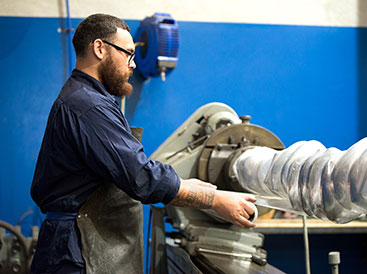 Man working on crankshaft